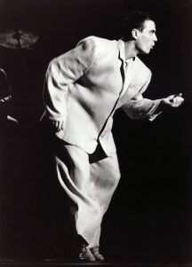 Black and white picture of David Byrne dancing in a boxy oversized suit from the Talking Heads concert film Stop Making Sense